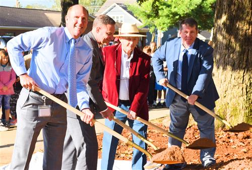 Mayor Finley, Superintendent Parker, Principal Jamie Golliver, former Principal W.R. Foutch with shovels at time capsule.